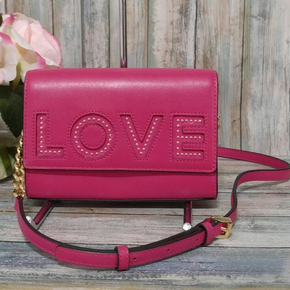60d6a5e00834 Michael Kors Ruby Love Crossbody Clutch. M_5ad9265d45b30ce52cb75087